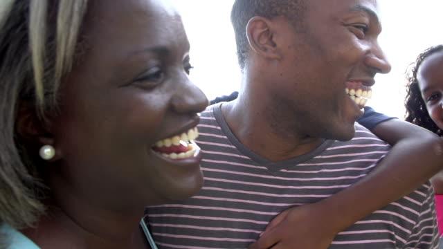 Multi Generation Family Giving Children Piggyback Rides video