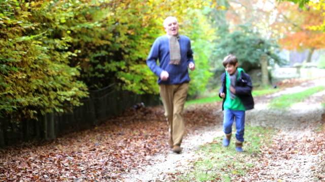multi generation family walking towards camera along autumn path video