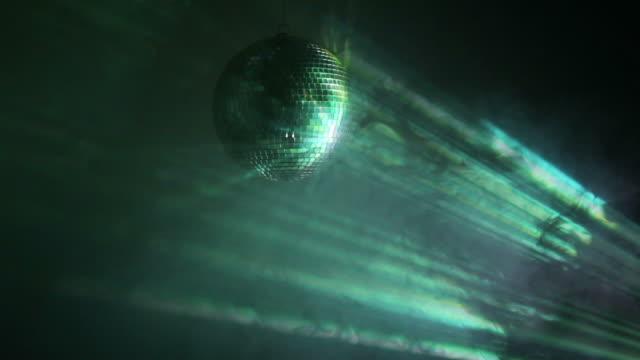Multicolor disco ball in smoke video