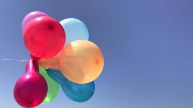 Multicolored balloons against the sky video