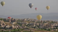 Multi-colored balloons fly over rocks video