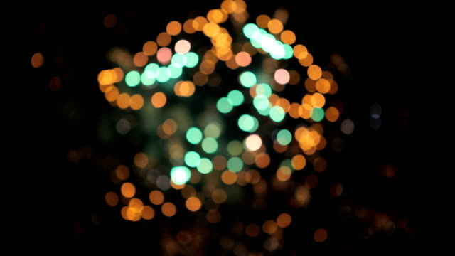 Multicolored defocused bokeh lights of exploding fireworks video