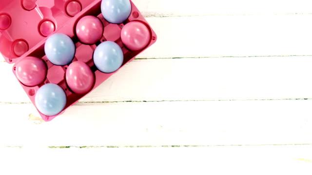 Multicolored Easter eggs in the carton video