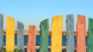 Multi-colored fence on the beach. video