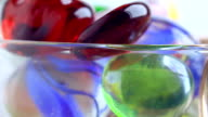 multicolored glass on a plate video