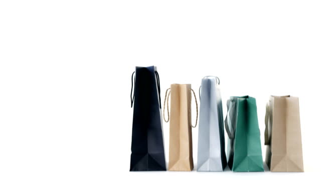 Multicolored shopping bags on white background video