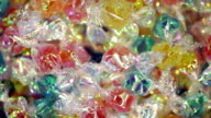 Multicolored sugar candies. Food background video