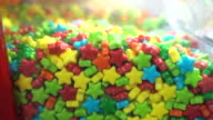 Multicolour pile of candy sweets food background, closeup view video