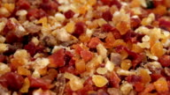 Multi-coloured slices of dried fruits video