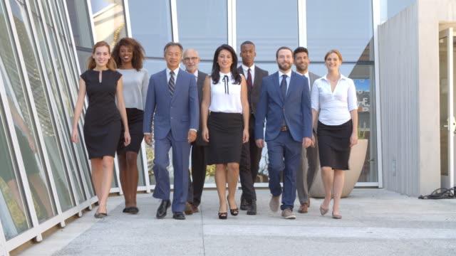 Multi-Cultural Business Team Walk Towards Camera Shot On R3D video