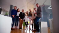 multicultural group of employees standing together during office studio meeting. video