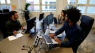 Multi-ethnic business people working in office video