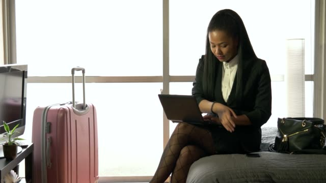 Multi-ethnic Businesswoman Woman Working With Computer Hotel Room Business Travel video