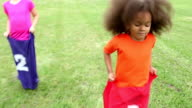 Multi-ethnic children in potato sack race video