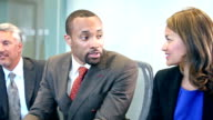 Multi-ethnic corporate business meeting video