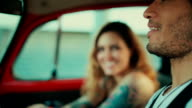 Multiethnic couple in a vintage car video