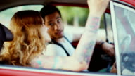 Multiethnic couple talking in a vintage car video