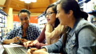 Multi-ethnic female college students in study group brainstorm about assignment video