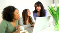 Multi-ethnic friends browsing the internet together video