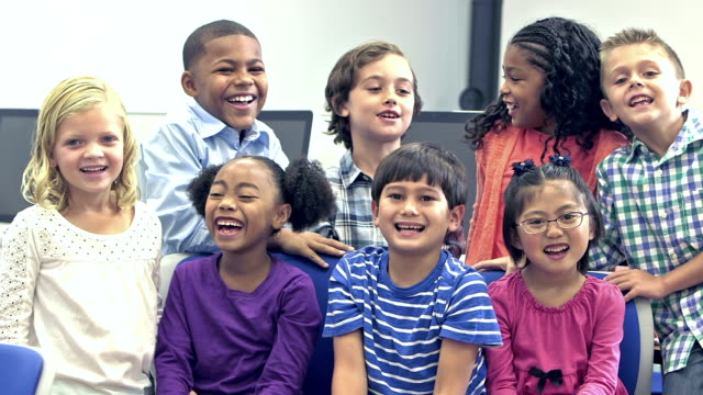 Multi-ethnic group of happy elementary school children video