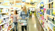 Multi-ethnic group of people shopping in personal care section of supermarket video