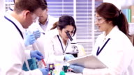 Multi-ethnic group of scientists in research laboratory. Science experiments. video