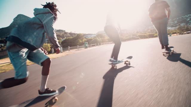 Multi-Ethnic Group of Skaters Skateboarding Down Street at Seasi video