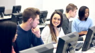 Multi-ethnic group of students in class on computers video