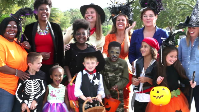 Multi-ethnic mothers and children in halloween costumes video