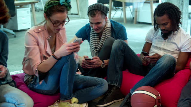 Multi-ethnic Startup Creative Young People typing on their phones. video