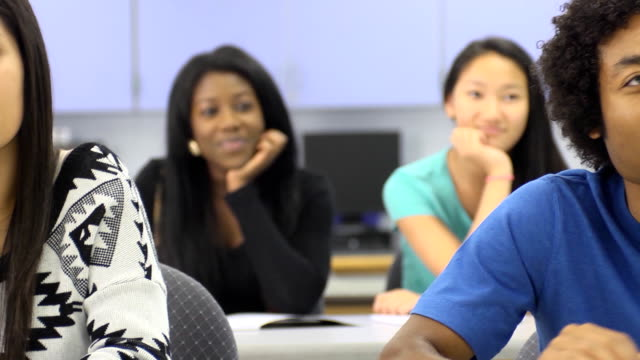 Multi-Ethnic Students in Classroom - Front focus video