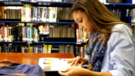 Multi-ethnic students studying at local or school library video