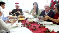 MultiGeneration Family Enjoying Christmas Meal Together video