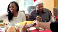 Multi-Generation Family Enjoying Christmas Meal Together video
