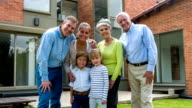 Multi-generation family outside their house video