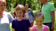Multi-Generation Family Walking Along Woodland Path Together video