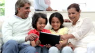 Multi-Generation Indian Family With Digital Tablet video