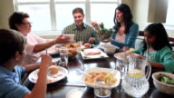 Multi-generational Hispanic family enjoying dinner and quality time together video