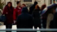 Multigenerational, multi ethnic anonymous crowds walking in the Millennium Bridge in London, England, UK video