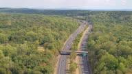 AERIAL: Multilane interstate expressway with New York cityline on the horizon video