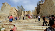 Multinational crowd of tourists viewing remains of ancient Parthenon in video