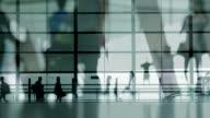Multiple Exposure of people walking at airport video