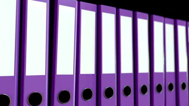 Multiple purple office binders. Loopable motion background video