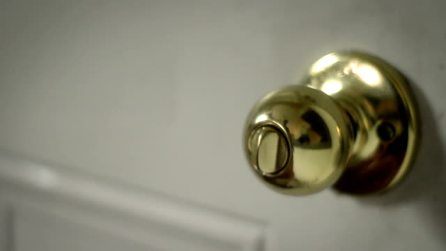 Multipurpose clip - Man locks and unlocks his doorknob basic lock video