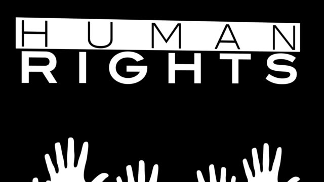 multiracial colored hands are raised for human rights video