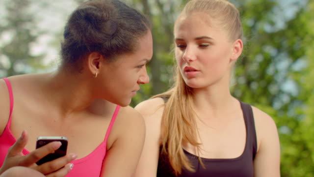 Multiracial girls talking in park. Closeup of multi ethnic women talking video