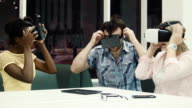 Multiracial team using virtual reality glasses video