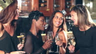 Multiracial women at a party with hats and champagne video
