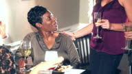 Multiracial women at restaurant talking to friends video