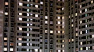 Multi-storey housing at late evening with windows lighting video
